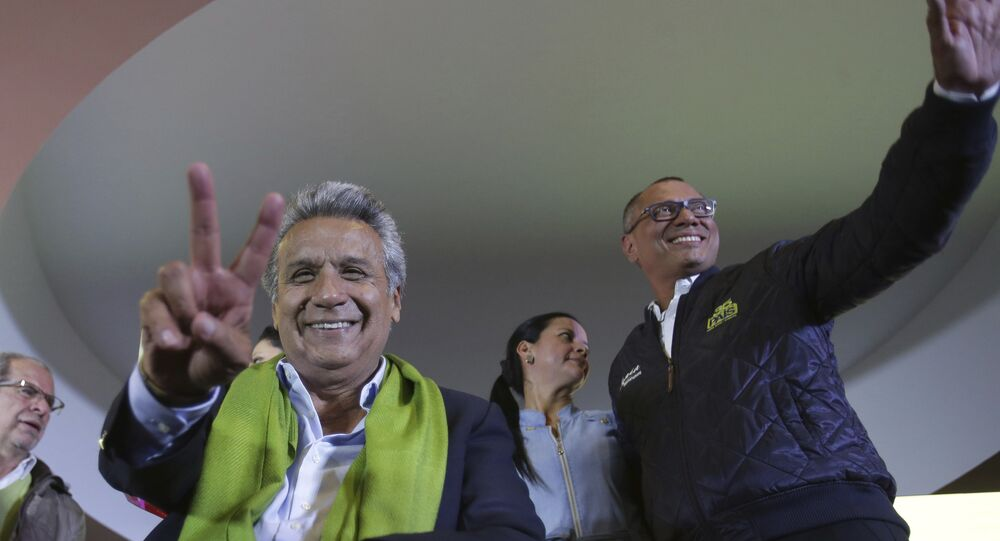 Alianza PAIS's presidential candidate Lenin Moreno, left, and his running mate Jorge Glas smile end of the day of the presidential election, in Quito, Ecuador, Sunday, April 2, 2017. Ecuador went to the polls in a second round presidential elections.
