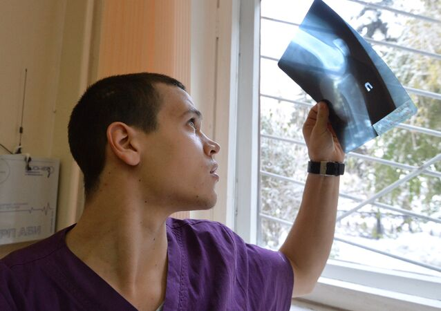 A traumotologist examines an X-ray image (File)