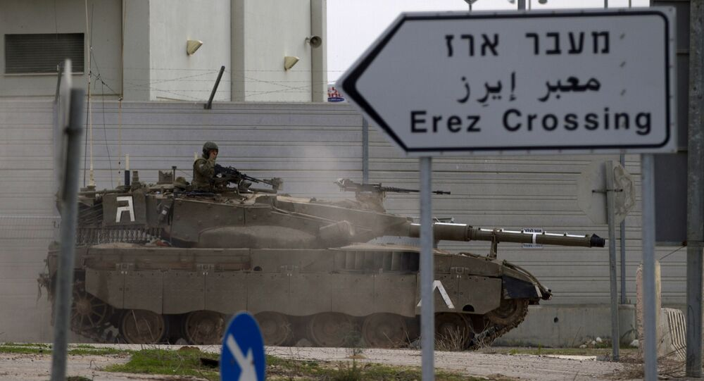 An Israeli tank drives next to Erez Border crossing between the Gaza strip and Southern Israel, Wednesday, Nov. 21, 2012.
