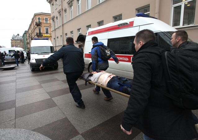Men carry an injured person on a stretcher outside Technological Institute metro station in Saint Petersburg on April 3, 2017