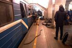 Blast victims lie near a subway train hit by a explosion at the Tekhnologichesky Institut subway station in St.Petersburg, Russia, Monday, April 3, 2017