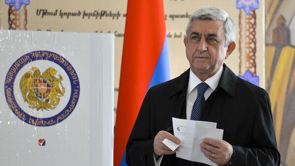 Armenia's President Serzh Sargsyan prepares to casts his ballot at a polling station during a parliamentary election in Yerevan, Armenia, Sunday, April 2, 2017 - Sputnik International