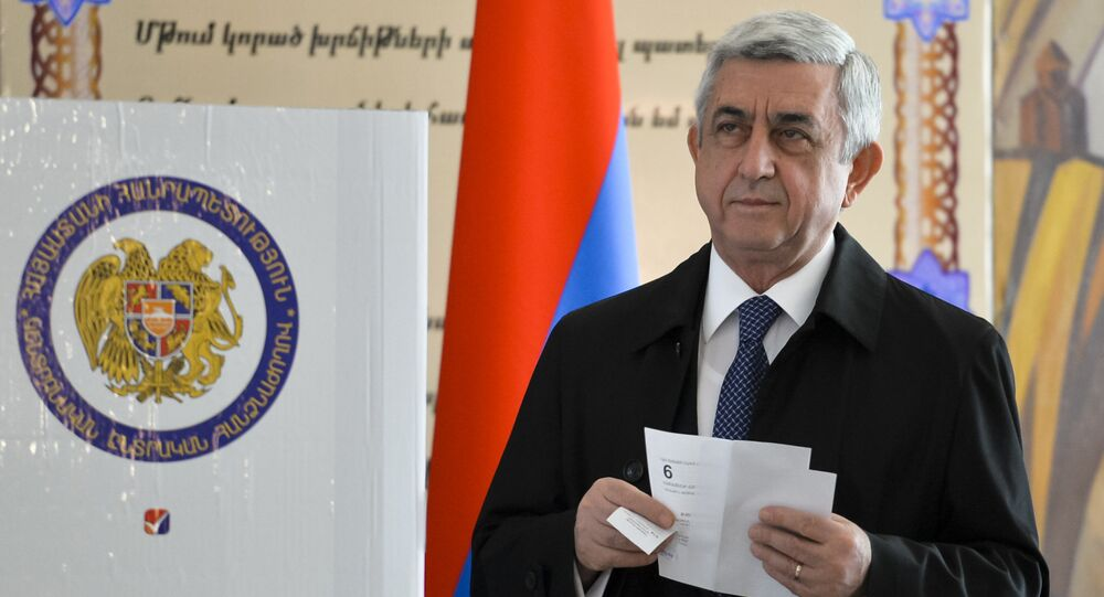 Armenia's President Serzh Sargsyan prepares to casts his ballot at a polling station during a parliamentary election in Yerevan, Armenia, Sunday, April 2, 2017