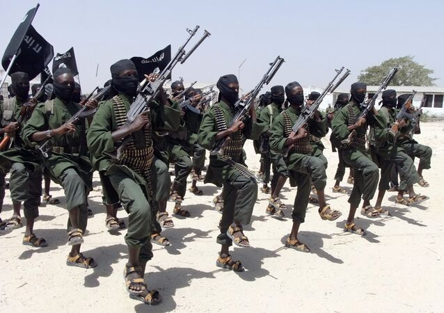 In this Thursday, Feb. 17, 2011 file photo, hundreds of newly trained al-Shabab fighters perform military exercises in the Lafofe area some 18 km south of Mogadishu, in Somalia