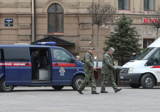 Members of the security services walk past a vehicle of Russia's Investigative Committee outside Sennaya Ploshchad metro station after an explosion tore through a train carriage in the St. Petersburg metro system, in St. Petersburg, Russia April 3, 2017
