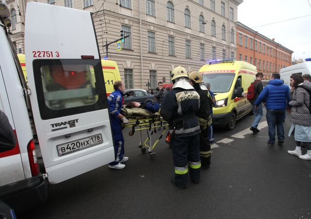 People carry a subway blast victim into an ambulance after explosion at Tekhnologichesky Institut subway station in St.Petersburg, Russia, Monday, April 3, 2017