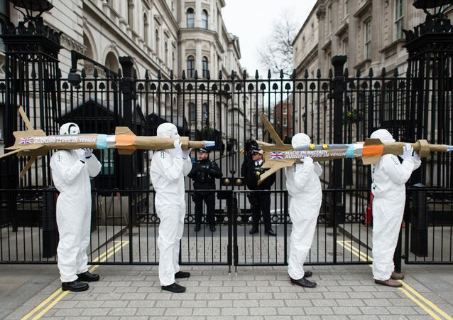 Campaigners from Amnesty International carry model missiles to Downing Street in central London on March 18, 2016 to highlight the export of UK-manufactered arms to Saudi Arabia