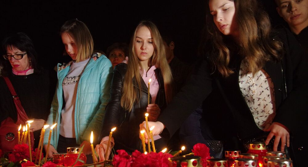 Participants of the action of memory of the St. Petersburg metro blast victims at Lenin Square in Simferopol
