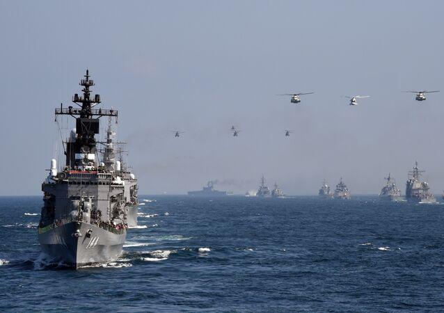 Japan's Maritime Self-Defense Force (MSDF) escort ship Kurama (L) takes part in a fleet review off Sagami Bay, Kanagawa prefecture (File)