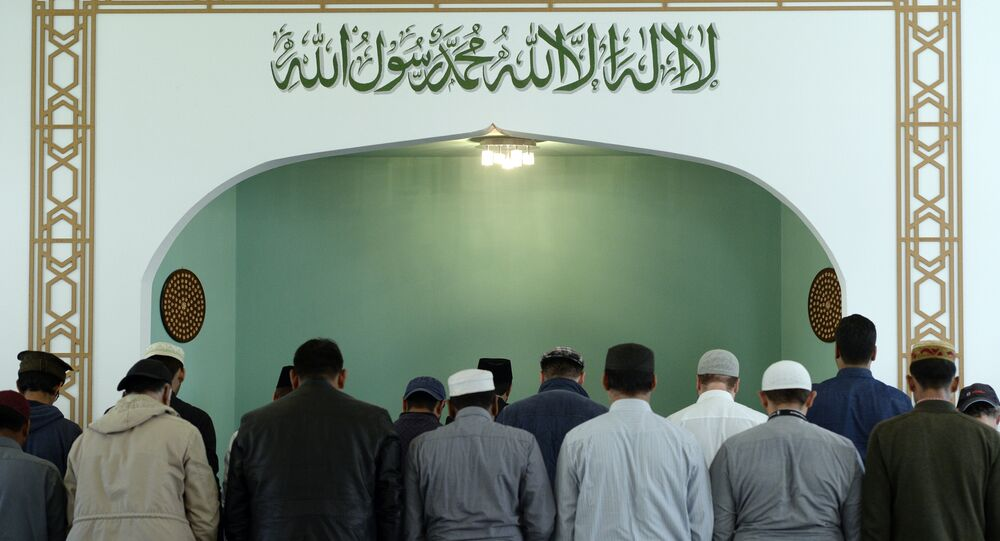 Men pray inside the Khadija mosque on October 3rd, 2016 in Berlin, during the Open-Mosque-Day. Every year on October 3rd, the Day of German Unity, hundreds of mosques invite visitors accross the country on the Day of the Open Mosque.
