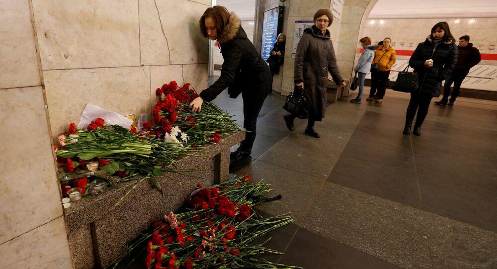 A woman lays flowers in memory of victims of a blast in St.Petersburg metro, at Tekhnologicheskiy institut metro station in St. Petersburg, Russia, April 4, 2017