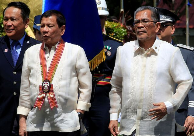 Philippine President Rodrigo Duterte (C) walks with Department of Interior and Local Government Secretary, Mr Ismael Sueno, during the Philippine National Police Academy (PNPA) graduation in Camp Castaneda, Silang town in Cavite city, south of Manila, Philippines March 24, 2017. Picture taken March 24, 2017