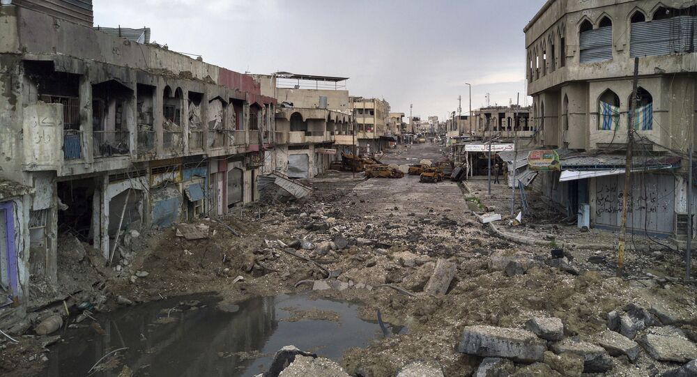 A neighborhood recently retaken by Iraqi security forces during fighting against Islamic State militants on the western side of Mosul, Iraq, Monday, April 3, 2017