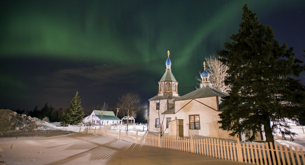 The aurora borealis, or northern lights, fill the sky early Sunday, March 17, 2013, above the Holy Assumption of the Virgin Mary Russian Orthodox church in Kenai, Alaska. The bright display at times filled the sky.