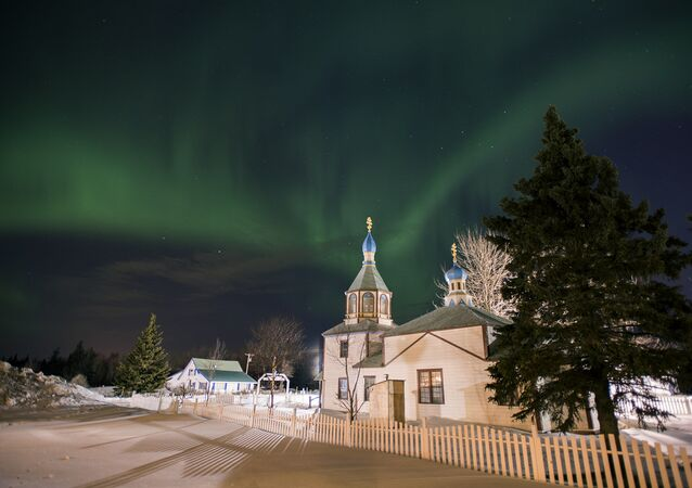 The aurora borealis, or northern lights, fill the sky early Sunday, 17 March 2013, above the Holy Assumption of the Virgin Mary Russian Orthodox church in Kenai, Alaska. The bright display at times filled the sky.