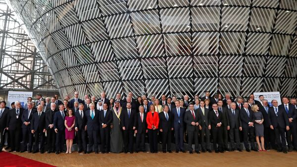 Foreign Ministers and officials pose for a group photo as they take part in an international conference on the future of Syria and the region, in Brussels, Belgium, April 5, 2017. - Sputnik International