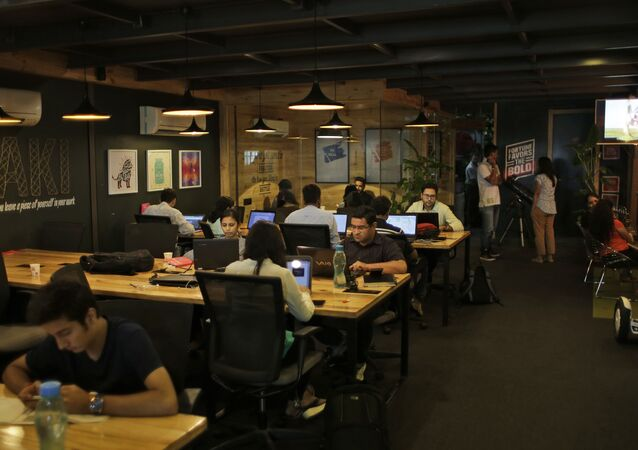 Young Indian entrepreneurs and freelancers work at Innov8, a lax co-working space in New Delhi, India. (File)