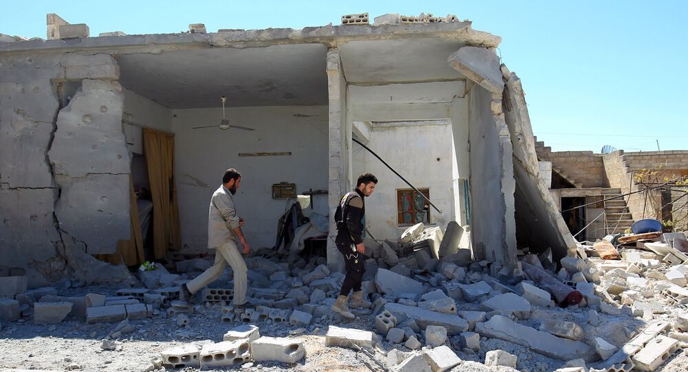 Civil defense members inspect the damage at a site hit by airstrikes on Tuesday, in the town of Khan Sheikhoun in rebel-held Idlib, Syria April 5, 2017