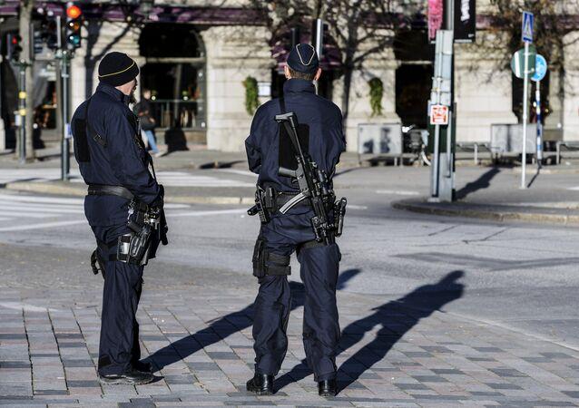 Armed police officers at the Gustaf Adolfs square in central Stockholm, Sweden on 21 November 2015.