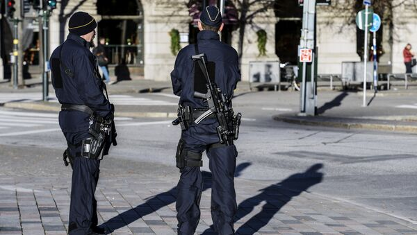 Armed police officers at the Gustaf Adolfs square in central Stockholm, Sweden (file) - Sputnik International
