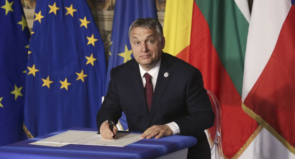 Hungary's Prime Minister Viktor Orban signs a document during the EU leaders meeting on the 60th anniversary of the Treaty of Rome, in Rome, Italy March 25, 2017.