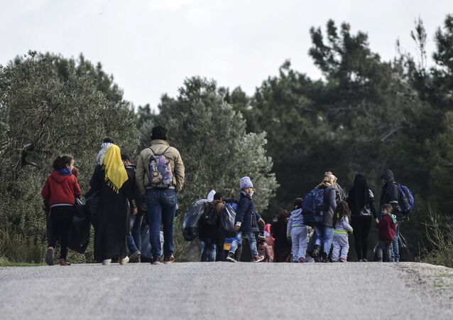 Syrian refugees walk back after a failed attempt to reach the Greek island of Lesbos early in the morning on March 3, 2016, at Dikili in Izmir.