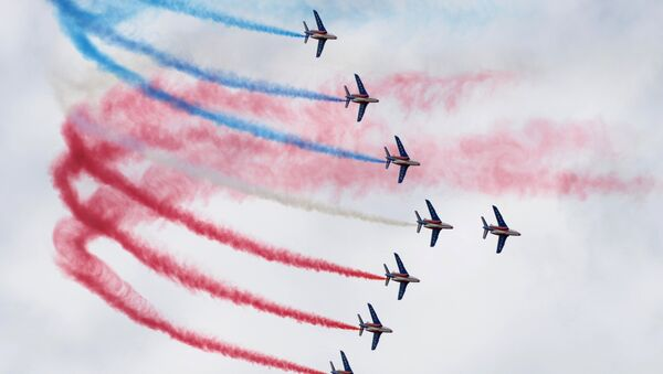 Alphajet aircrafts from the French elite acrobatic flying team Patrouille de France (PAF) release smoke in the colors of the French flag at the International Paris Airshow at Le Bourget. (File) - Sputnik International