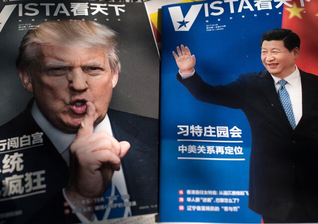Magazines' front pages featuring US President Donald Trump (L) and China's President Xi Jinping (R) are displayed at a news stand in Beijing