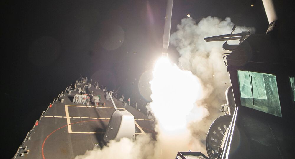 US Navy guided-missile destroyer USS Ross (DDG 71) fires a tomahawk land attack missile in Mediterranean Sea which U.S. Defense Department said was a part of cruise missile strike against Syria on April 7, 2017.