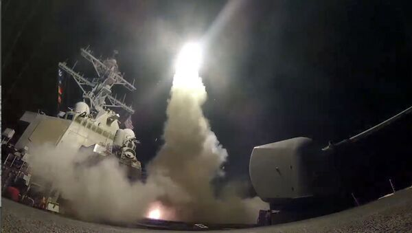 In this image from video provided by the U.S. Navy, the guided-missile destroyer USS Porter (DDG 78) launches a tomahawk land attack missile in the Mediterranean Sea, Friday, April 7, 2017. - Sputnik International