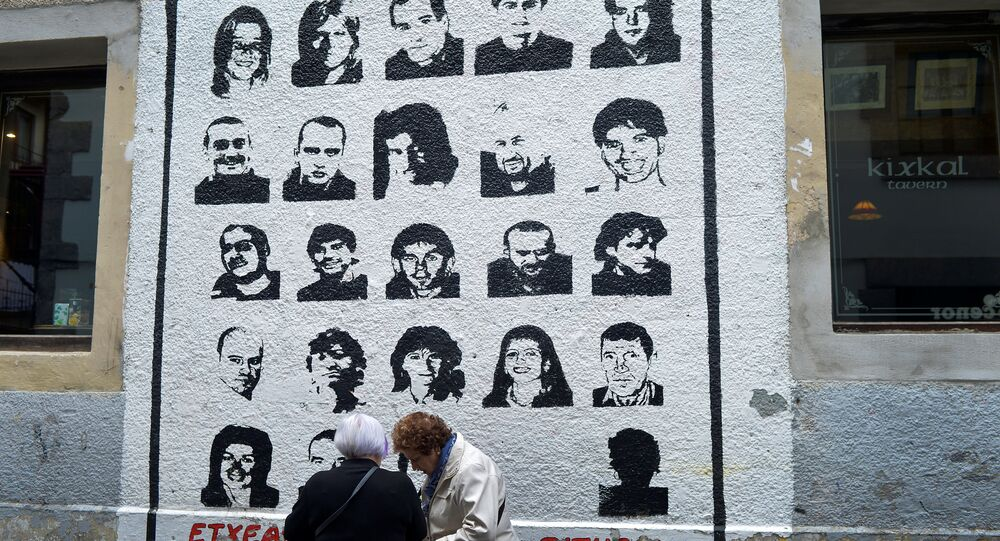 Women speak alongside a mural depicting imprisoned armed Basque group ETA members, under which reads We Want Them Home, in the Basque town of Hernani, Spain March 31, 2017.