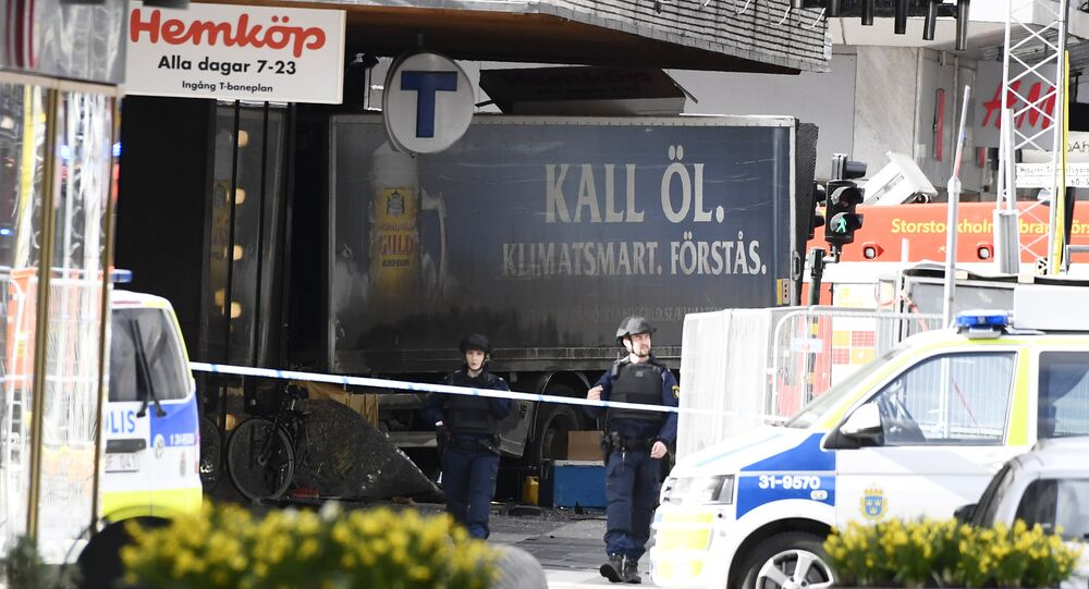 Police cordon off the truck which crashed into the Ahlens department store at Drottninggatan in central Stockholm
