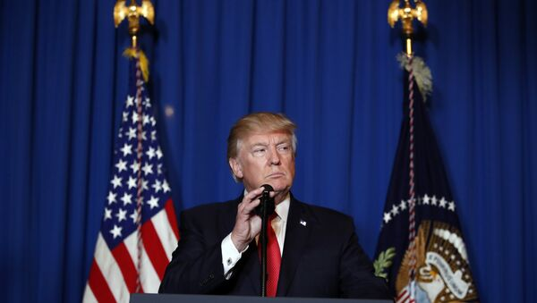 President Donald Trump speaks at Mar-a-Lago in Palm Beach, Fla., Thursday, April 6, 2017, after the U.S. fired a barrage of cruise missiles into Syria Thursday night in retaliation for this week's gruesome chemical weapons attack against civilians. - Sputnik International