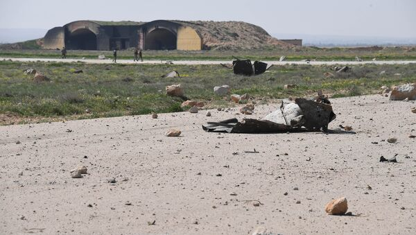 The aftermath of a US missile strike at the Shayrat military field in Syria - Sputnik International