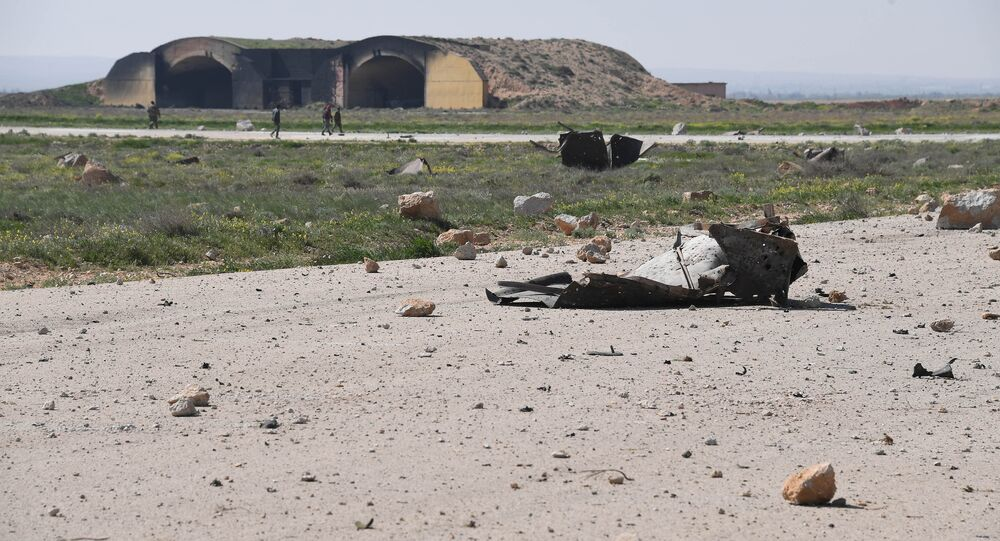 The aftermath of a US missile strike at the Shayrat military field in Syria