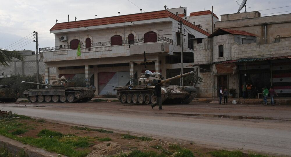 Armored vehicles in a village in the north of Hama, Syria