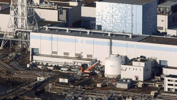 An aerial view shows the quake-damaged Fukushima nuclear power plant in the Japanese town of Futaba, Fukushima prefecture on March 12, 2011. (File) - Sputnik International