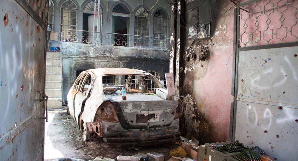 Burned car in Mosul