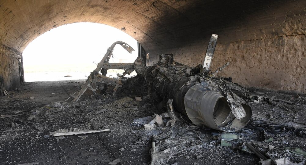 The body of a plane burned as a result of the US missile attack on an air base in Syria