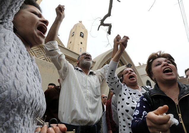 Relatives of victims react in front of a Coptic church that was bombed on Sunday in Tanta, Egypt, April 9, 2017