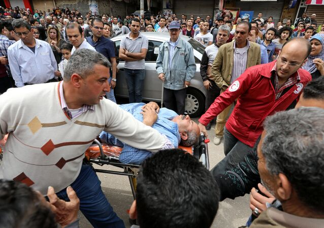 A victim is seen on a stretcher after a bomb went off at a Coptic church in Tanta, Egypt, April 9, 2017