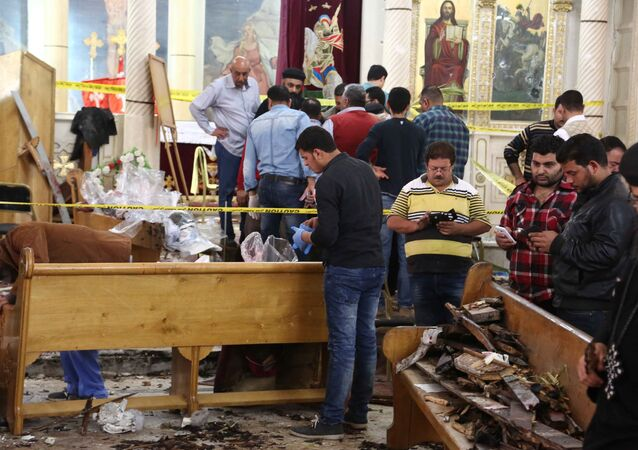 A general view shows forensics collecting evidence at the site of a bomb blast which struck worshippers gathering to celebrate Palm Sunday at the Mar Girgis Coptic Church in the Nile Delta City of Tanta, 120 kilometres (75 miles) north of Cairo, on April 9, 2017
