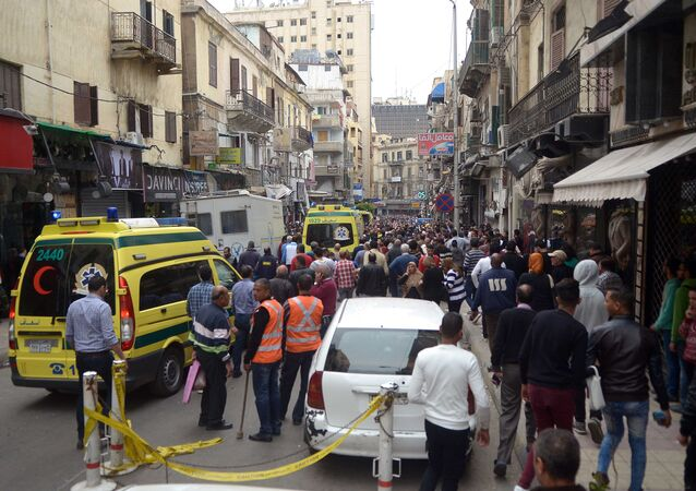 Egyptians gather at near a church in Alexandria after a bomb blast struck worshippers gathering to celebrate Palm Sunday on April 9, 2017