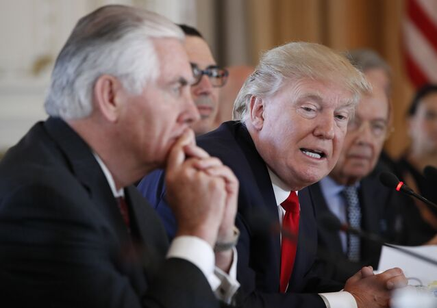 President Donald Trump, joined by Secretary of State Rex Tillerson, left, speaks during a bilateral meeting with Chinese President Xi Jinping at Mar-a-Lago, Friday, April 7, 2017, in Palm Beach, Fla