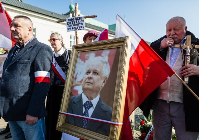 Supporters of the ruling Law and Justice party (PiS) attend a ceremony marking the seventh anniversary of the presidential plane crash in Smolensk, in front of the presidential palace in Warsaw, on April 10, 2017