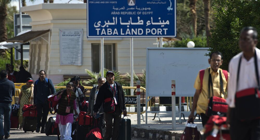 Tourists from India arrive in Egypt after crossing the Taba Land Port on February 18, 2014