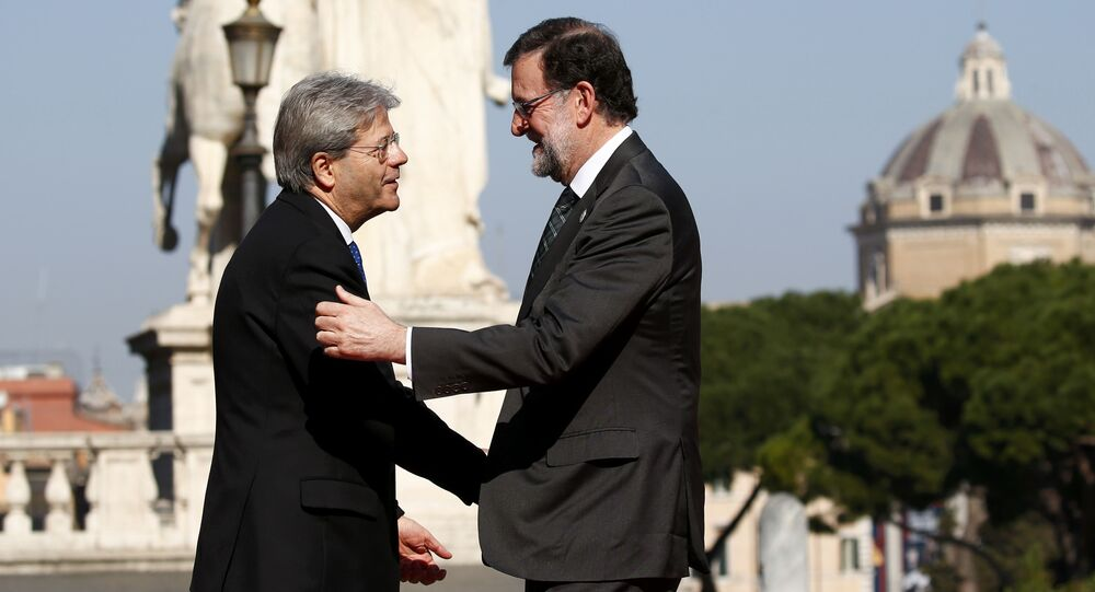 Spain's Prime Minister Mariano Rajoy is welcomed by Italy's Prime Minister Paolo Gentiloni outside the city hall Campidoglio (Capitoline Hill) as EU leaders arrive for a meeting on the 60th anniversary of the Treaty of Rome, in Rome, Italy March 25, 2017.