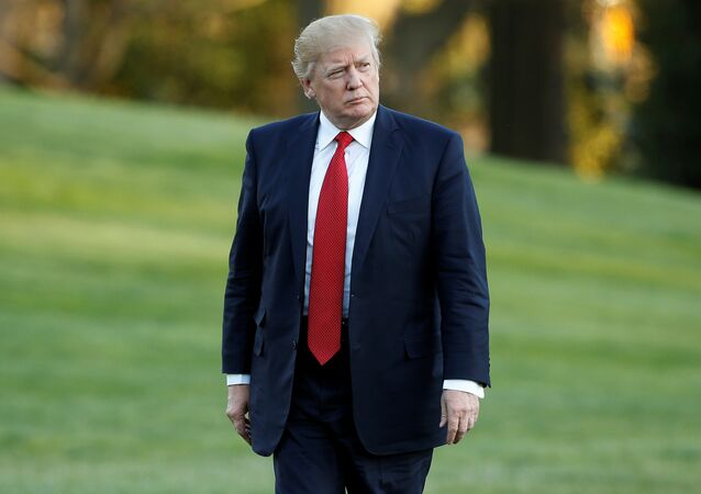 US President Donald Trump walks from Marine One upon his return to the White House in Washington, US, April 9, 2017.