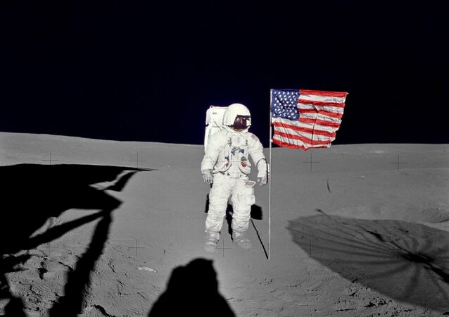 Apollo 14 Mission image - Astronaut Edgar D. Mitchell, lunar module pilot for the Apollo 14 lunar landing mission, stands by the deployed U.S. flag on the lunar surface during the early moments of the first extravehicular activity (EVA-1) of the mission.