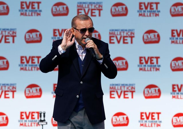Turkish President Tayyip Erdogan addresses his supporters during a rally for the upcoming referendum, in Izmir, Turkey, April 9, 2017.